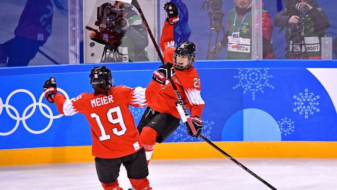 Switzerland forward Alina Muller (25) celebrates a goal against Korea with defenseman Christine Meier (19) during women's ice hockey Group B play in the Pyeongchang 2018 Olympic Winter Games at Kwandong Hockey Centre.
