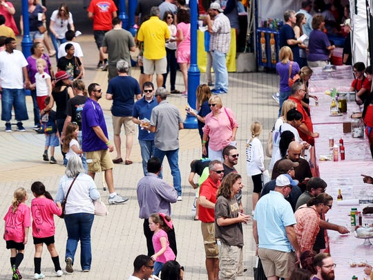 People line up for food during the Red River Revel Saturday afternoon in Festival Plaza.