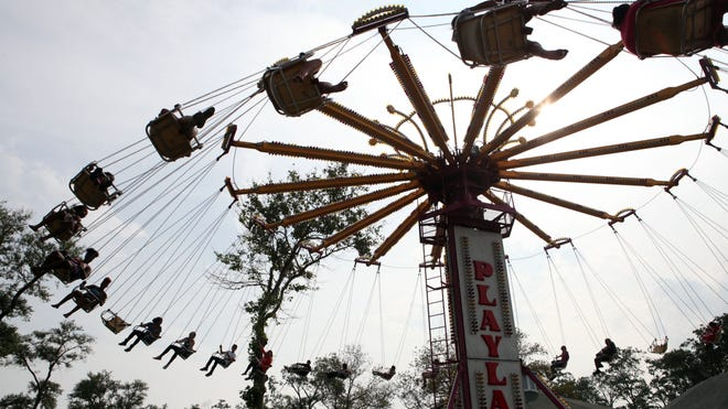 People enjoy the rides at Playland, Aug. 31 in Rye.