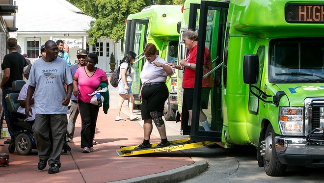 Rover riders exit and board buses at the main hub at the corner of Burton Street and Walnut Street as the Murfreesboro mass transit  system celebrated nine years of operation with free fares and food Thursday.