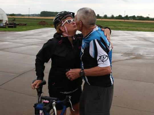Jim Green of Des Moines gets a kiss from his daughter, Joanie Mousel, before heading out to ride the RAGBRAI pre-ride route on Sunday, June 1, 2014.