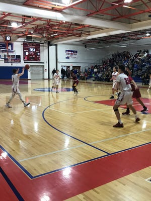 Action from Friday night's game pitting Ithaca against Owego.