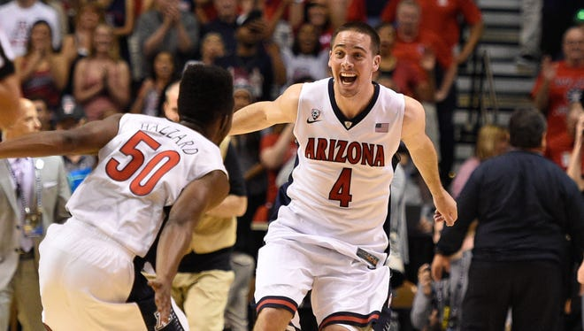 Arizona Wildcats guard T.J. McConnell (4) celebrates with guard Jacob Hazzard (50) after the Pac-12 championship game.