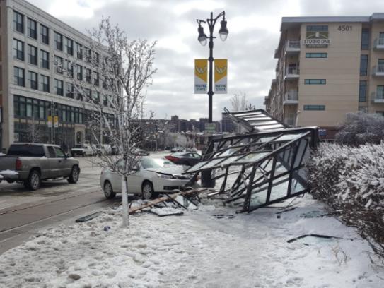 A car struck a bus stop shelter Friday morning, injuring