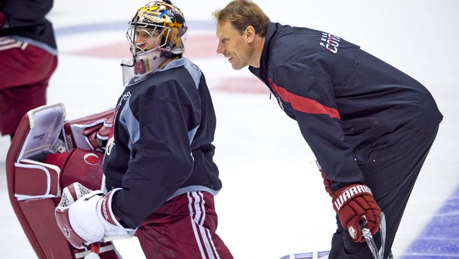 Coyotes goaltending coach Sean Burke talks with goalie Mike Smith after practice at Jobing.com Arena on October 31, 2011.
