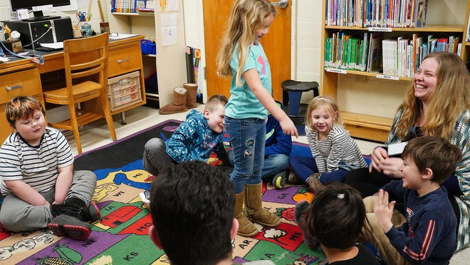 """In Rochester, Chamberlain Street School kindergartners play a game of """"Doggy, doggy, where\s your bone?"""" during an after-school program. A survey in New Hampshire indicates parents are split on whether it's a good idea for students to return to school buildings for in-person learning in 2020-21."""