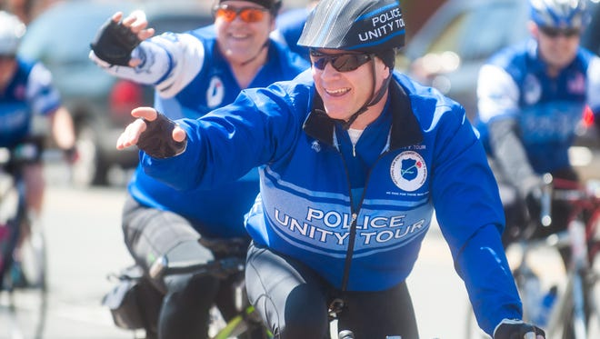 Millville Police Captain Harrison Cranmer waves to his son Benjamin during the 2017 Police Unity Tour.
