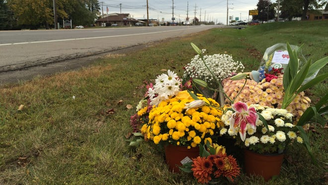 A memorial has blossomed along Empire Road in Penfield, near the spot where Amy Menz, 30, was killed when hit by three eastbound cars Saturday night.