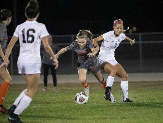 Mariner's Cassidee Rentsch tries to get the ball from Lely's Stephanie Carter in the Region 3A-4 girls soccer quarterfinal game on Tuesday, Feb. 6, 2018, in Cape Coral.