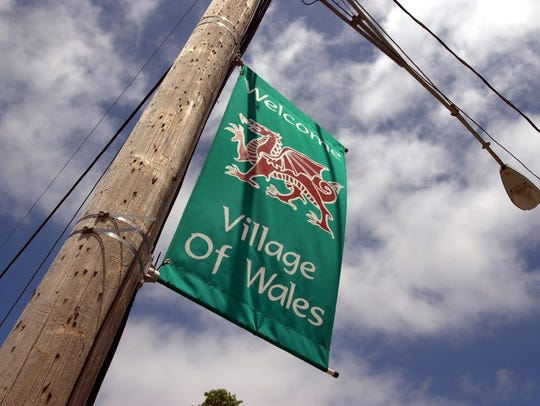 A banner hangs from a utility pole outside the Village