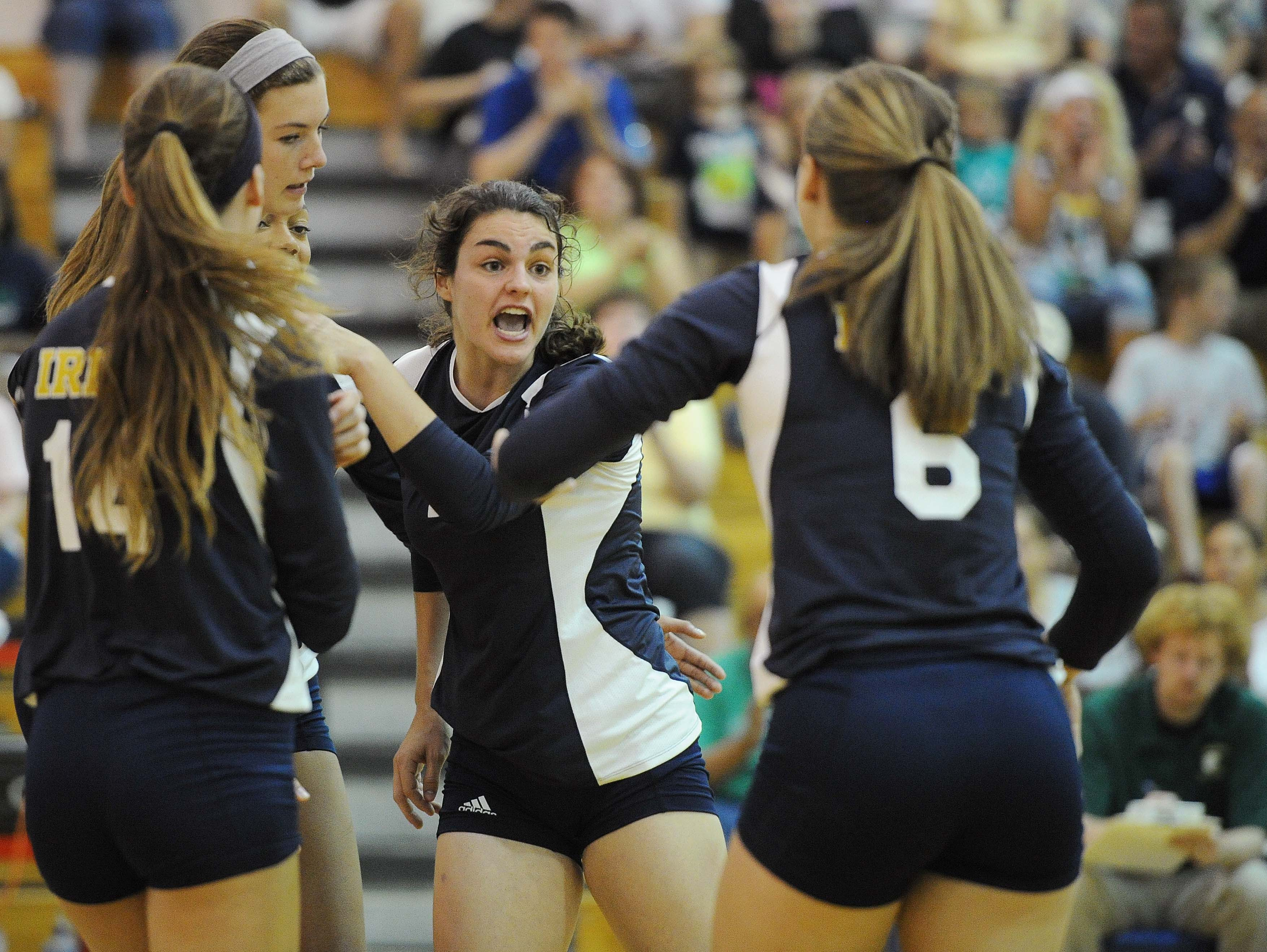 The Cathedral team talks after winning a point. Cathedral hosted number one nationally ranked Assumption (KY) in girls high school volleyball Saturday August 24, 2013. Rob Goebel/The Star.