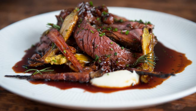 Rosemary-garlic lamb roast with buttery whipped roots, sour cherry jus and wintery herbs at The Love in Philadelphia.