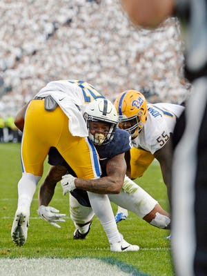Penn State's Marcus Allen gets a safety against Pittsburgh's Kollin Smith in the second half of an NCAA Division I college football game Saturday, Sept. 9, 2017, at Beaver Stadium. Penn State defeated Pitt 33-14.