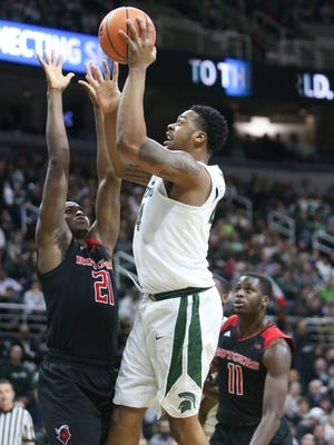 Michigan State forward Nick Ward scores against Rutgers forward Mamadou Doucoure during the first half on Wednesday, January 10, 2018 at the Breslin Center in East Lansing.