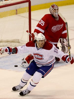 Pierre-Alxeandre Parenteau celebrates after the Detroit Red Wings Jimmy Howard gives up a goal to the Montreal Canadiens P.K. Subban during second period action on Sunday, November 16, 2014 at Joe Louis Arena in Detroit.