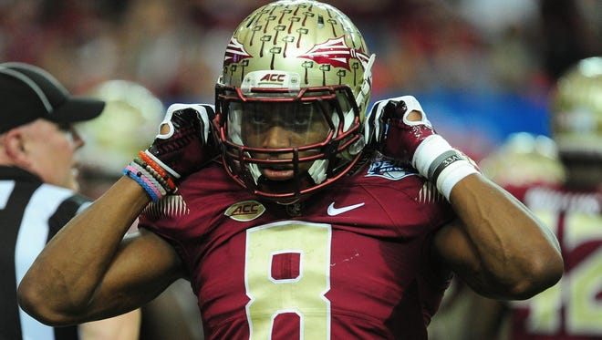 Jalen Ramsey of the Florida State Seminoles heads off the field against the Houston Cougars during the Chick-Fil-A Peach Bowl at the Georgia Dome on December 31, 2015 in Atlanta, Georgia.