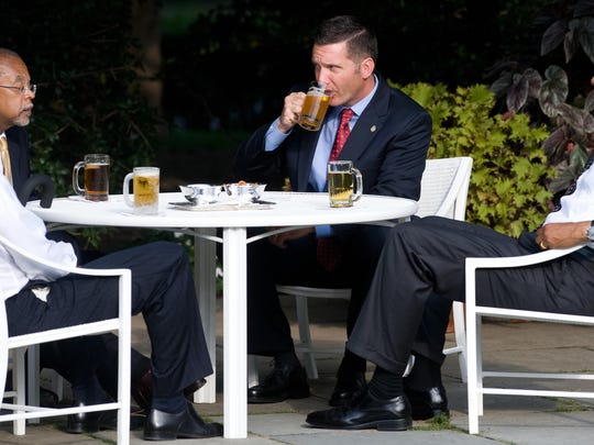 """Police Sergeant James Crowley (2nd R) of Cambridge, Massachusetts, drinks a beer with Harvard Professor Henry Louis Gates Jr. (2nd L), alongside US President Barack Obama (R) and US Vice President Joe Biden (L) as they share beers on the South Lawn near the Oval Office at the White House in Washington, DC, July 30, 2009. In an effort to curb controversy, the so-called """"Beer Summit,"""" is being held after Crowley arrested Gates at his home on July 16, sparking tensions and racial furor."""