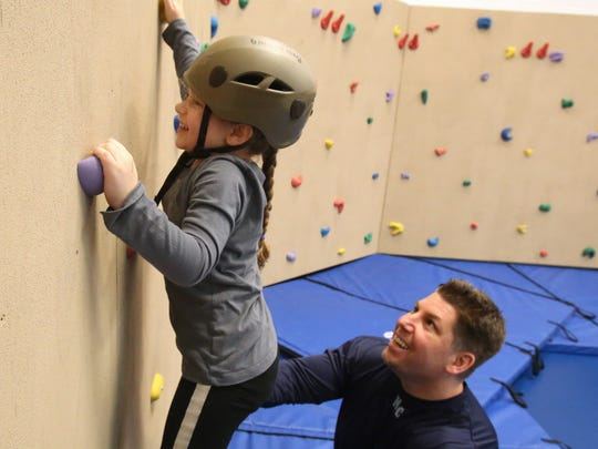 Joe Farina of Nanuet helps his daughter, Gianna, 5, on a climbing wall during the Town of Ramapo's February Break Camp at the Joseph T. St. Lawrence Community, Health and Sports Center in Hillburn Feb. 19, 2014.