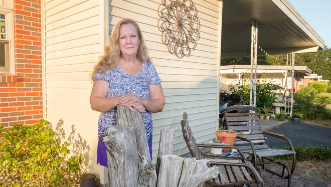 Cheryl Kursave stands outside of her house in Milton on Thursday, October 5, 2017.