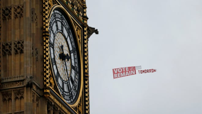 A pro-EU banner being towed behind a plane passes Big Ben in the Houses of Parliament  in London on June 22, 2016, on the final day of the EU referendum campaign before Britain goes to the polls to vote on continuing its membership in the EU.