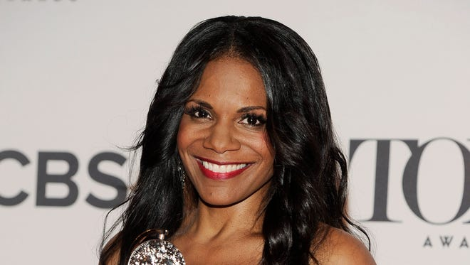 "Audra McDonald poses in the press room with her award for best actress in a leading role in a play for ""Lady Day at Emerson's Bar & Grill,"" at the 68th annual Tony Awards at Radio City Music Hall on Sunday, June 8, 2014, in New York."
