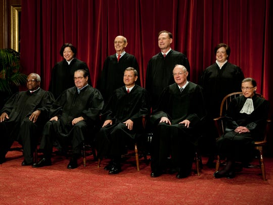 The Supreme Court sits for an official portrait in
