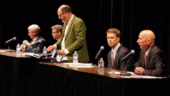 6th Congressional candidates Glen Grothman, Tom Denow, moderator Rick Dodgson, Joe Leibham and Duey Stroebel on stage at the candidate debate Wednesday July 30, 2014 at Plymouth High School in Plymouth.