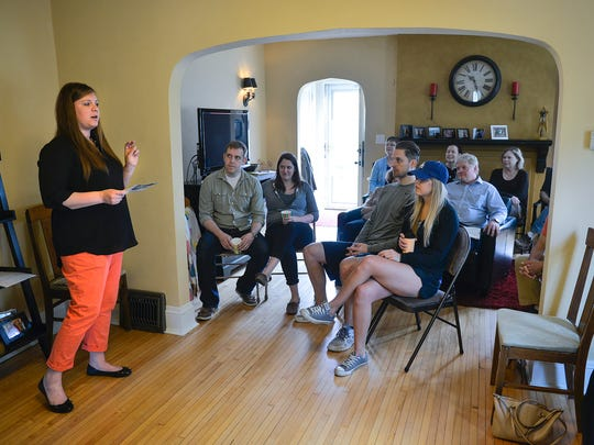 Kristen Berreau, co-president of the Southside University Neighborhood Association, addresses members of the association during a meeting at her home April 16, 2016, in St. Cloud.