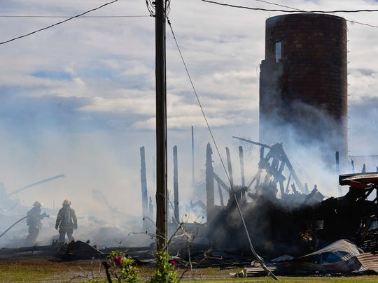 Firefighters from Rockville, Kimball, and Watkins work to extinguish a smoky fire in a barn and another building Monday afternoon, June 6, across from Pearl Lake at 10117 Stearns County Road 8 near the town of Marty.