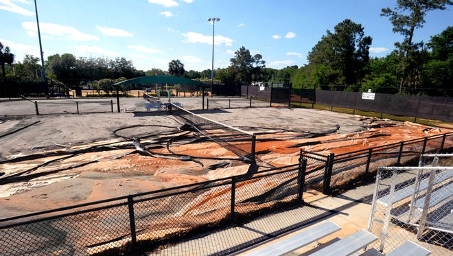 In this 2014 file photo, damage is visible on some of the clay tennis courts at Roger Scott Tennis Center after a storm.