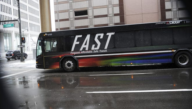 A Fast bus heads eastbound on Larned Street in downtown.