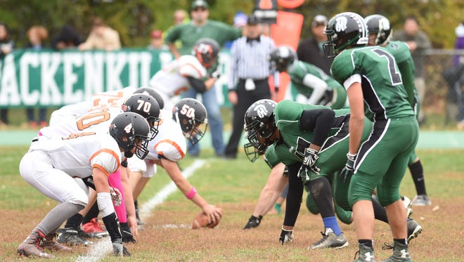 The Spackenkill High School football team, left, hosts Dover on its grass field in an October 2015 game. Spackenkill Superintendent Mark Villanti said the district is in preliminary discussions to replace the grass with turf.