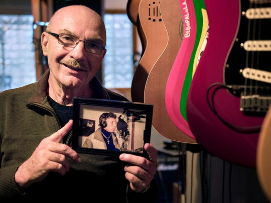 "Wes Henley, of Jackson, poses for a portrait with a photograph of music legend Carl Perkins on Wednesday, Jan. 17, 2017, at Highland House Productions in Jackson. Henley played guitar in Perkins' band and owns a photograph of his last ever recording session in October 1997. ""We were just instant friends,"" Henley said. ""It just clicked. We toured the world together; I've been all over the world with Carl."""