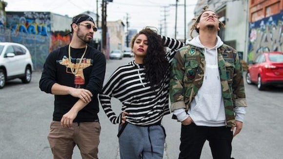 Members of LFDC, an El Paso born hip-hop group. From left to right; Tobias Brown, Krystall Poppin and Mikey Cloud.