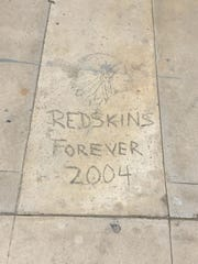 A carving on cement at Tulare Union High School located just off the Kern Avenue entrance.