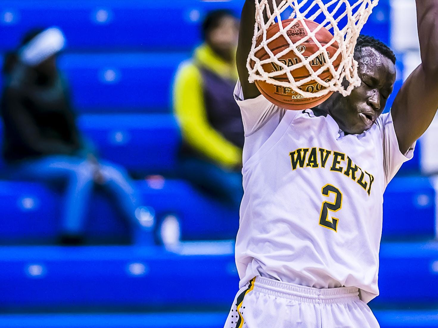 Emmanuel Gildo ,2, of Waverly slams the ball over a Fredrick Douglass defender during their Holiday Hoops Invitational game Tuesday December 29, 2015 at Lansing Community College. KEVIN W. FOWLER PHOTO