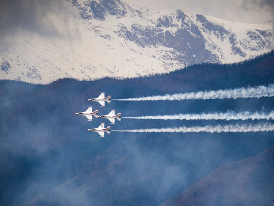 The Air Force Thunderbirds practice in the skies above