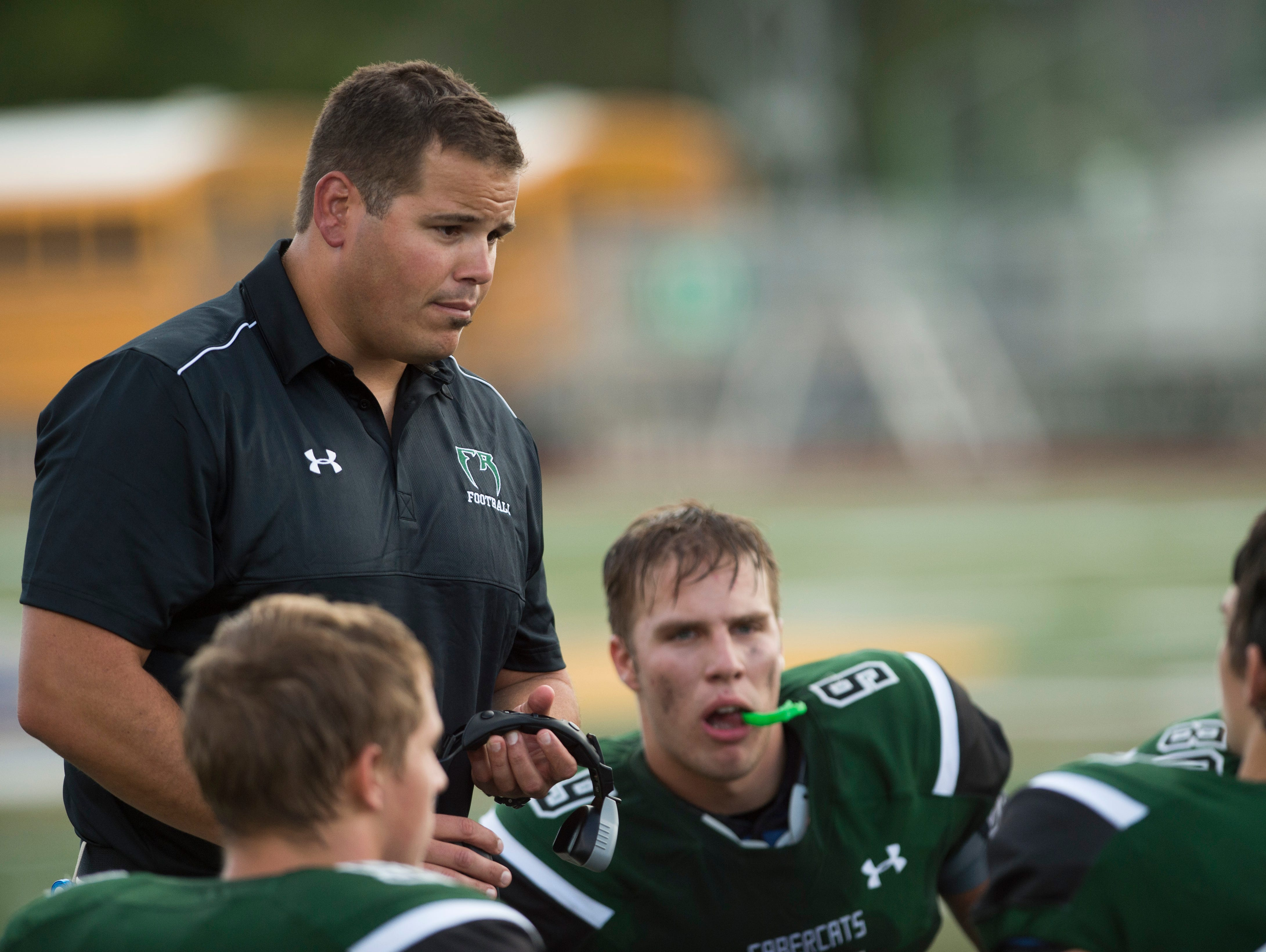 Former Fossil Ridge High School football coach Brian Tinker speaks with the team during a time out Sept. 3, 2015, at French Field. Tinker was relieved of his duties March 25.