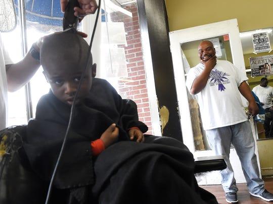 Bishop Marcus Campbell stops in at Wares Barbershop