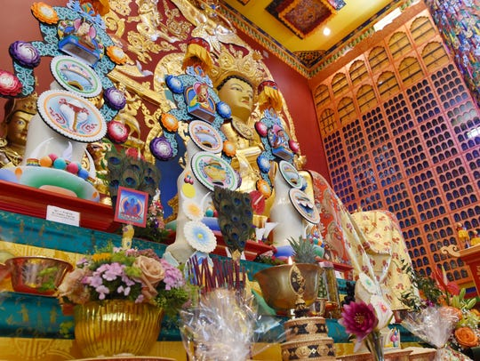 Offerings of flowers, fruit and sweets for the Buddha