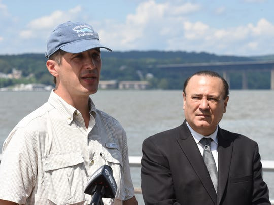From left, Andy Bicking, Scenic Hudson's director of public policy speaks while New York State Assemblyman Frank Skartados listens during a press conference at Long Dock Park in Beacon on Friday.  Skartados organized local political leaders and environmental groups to hold Friday's press conference in response to the proposed Hudson River anchorages.