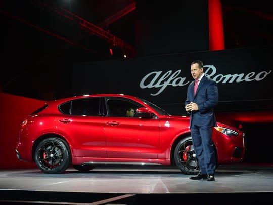Reid Bigland, head of Alfa Romeo, unveils the 2018 Alfa Romeo Stelvio SUV at the 2016 LA Auto Show in Los Angeles, California on November 16, 2016.