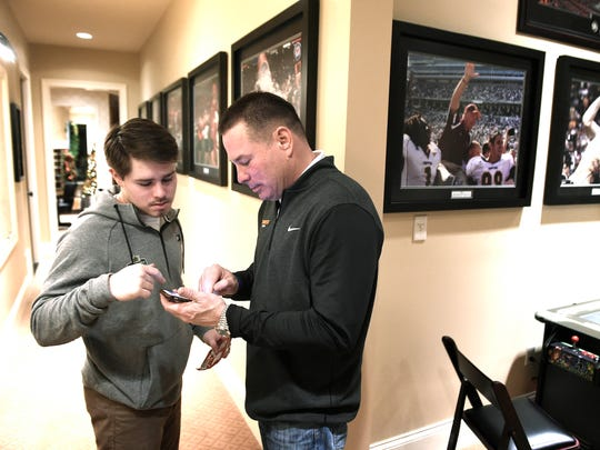 Butch Jones talks to his son Alex at his Knoxville home. Thursday Dec. 22, 2016, in Knoxville, Tenn.