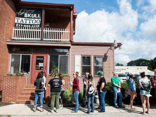 Dozens of customers line up outside Gypsy Skull Tattoo at 947 Carlisle St. in Hanover during a flash friday sale.