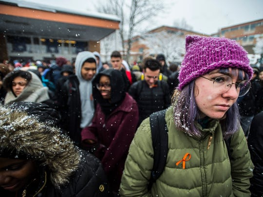 Burlington High School students gather outside on Wednesday morning, March 14, 2018, joining school across the country in a National School Walkout day. Burlington, Vt., was one of only a handful of schools that held classes while others cancelled due to a snow storm.