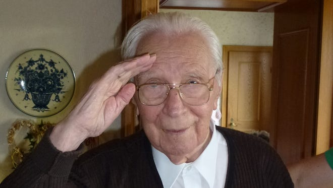 Karl Hense, a 91-year-old who fought for Germany in World War II, offers an overseas salute to Kelly Chapman, an American veteran living in New Hope.