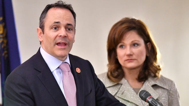 Kentucky Governor Matt Bevin, left, addresses the opening conference of The Open Hearts/Open Homes Summit, Friday, Mar. 10, 2017 in Frankfort Ky. Right is Kentucky First Lady Glenna Bevin. (Timothy D. Easley/Special to the C-J)
