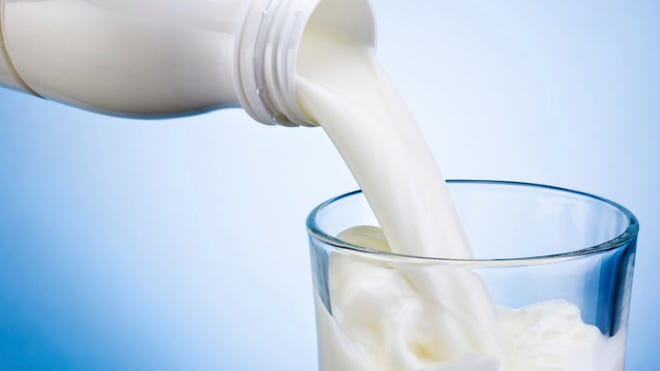 Wisconsin health officials say 38 people associated with the Durand High School football team became sick in an outbreak caused by raw milk served at a potluck dinner in September.