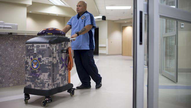 Six germ-killing robots are being pressed into service at the Phoenix VA hospital.