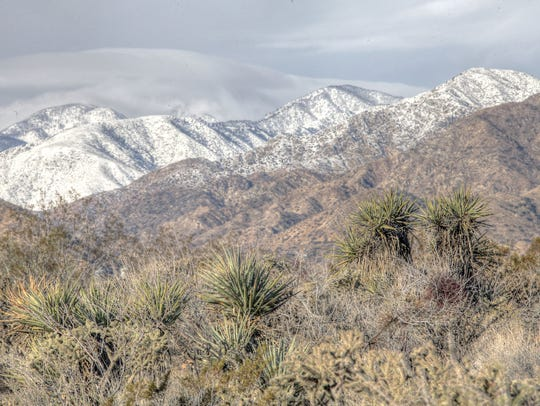 Snow covers the foothills above Morongo Valley on the